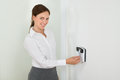 Businesswoman inserting keycard in security system young smiling while door Royalty Free Stock Image
