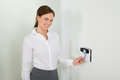 Businesswoman inserting keycard in security system young smiling while door Stock Image