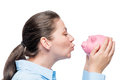 businesswoman kisses her favorite pink piggy bank on a white Royalty Free Stock Photo