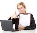 Businesswoman with laptop, clipboard and thumb up Royalty Free Stock Photography