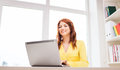 Businesswoman with laptop computer in office Royalty Free Stock Photo