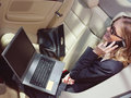 Businesswoman with laptop l business travel busy in car Royalty Free Stock Photo