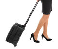 Businesswoman legs with a suitcase Royalty Free Stock Image