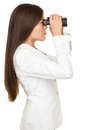 Businesswoman looking through binoculars side view of young isolated over white background Royalty Free Stock Photography