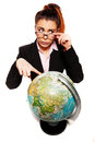 Businesswoman looking dumb pointing to a globe attractive and unsure when an earth on white background Royalty Free Stock Images