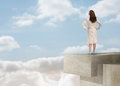 Businesswoman looking at the horizon over the clouds on a structure Royalty Free Stock Photos