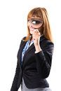 Businesswoman looking through magnifying glass isolated white Stock Photography