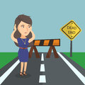 Businesswoman looking at road sign dead end.