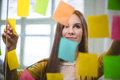 Businesswoman looking at sticky notes on glass Royalty Free Stock Photo