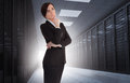 Businesswoman looking thoughtful in data center with light shining the darkness Royalty Free Stock Images