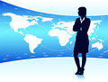 Businesswoman looking at world map standing beside Royalty Free Stock Photo