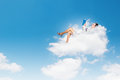Businesswoman lying on clouds image of with book Royalty Free Stock Photography