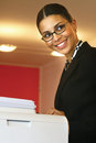 Businesswoman making copies l Royalty Free Stock Photo