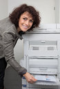 A businesswoman is making copies in an office she looking away from the camera horizontally framed shot Royalty Free Stock Images