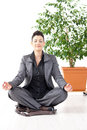 Businesswoman meditating Royalty Free Stock Image