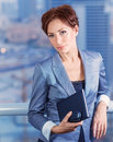 Businesswoman on the meeting attractive serious female waiting for a business partners big boss in financial corporation good job Royalty Free Stock Images