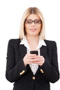 Businesswoman with mobile phone confident mature holding and smiling while standing isolated on white Stock Photos