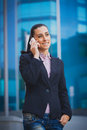 Businesswoman on the modern building background portrait of smiling Royalty Free Stock Images