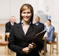 Businesswoman with notebook and co-workers Royalty Free Stock Photography