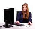 Businesswoman at the office desk side view portrait of young using computer Royalty Free Stock Photography