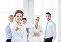 Businesswoman in office showing thumbs up Royalty Free Stock Photo
