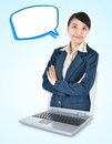 Businesswoman out of laptop with arms folded asian and text balloons isolated on blue background Royalty Free Stock Photos