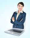 Businesswoman out of a laptop with arms folded beautiful asian isolated on blue background Stock Image