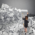 Businesswoman with paper sheet anywhere. Buried by bureaucracy concept. Royalty Free Stock Photo