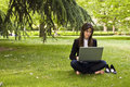 Businesswoman in the park Royalty Free Stock Image