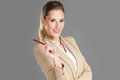 Businesswoman with pen picture of over grey background Stock Photo