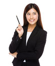 Businesswoman with pen up isolated on white background Stock Photos