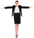 Businesswoman performing a balancing act on white background Stock Photography