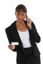 Businesswoman with a phone and blank business card Royalty Free Stock Photos