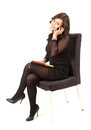 Businesswoman with phone sitting on chair Royalty Free Stock Photography