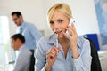 image photo : Woman in office talking on the phone
