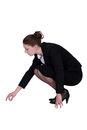Businesswoman picking a speck up off the floor Stock Images