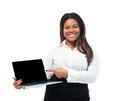 Businesswoman pointing on blank laptop screen cheerful afro american finger isolated a white background looking at camera Royalty Free Stock Image