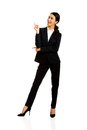 Businesswoman pointing at copyspace happy Royalty Free Stock Photo