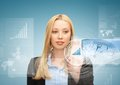 Businesswoman pointing at graph Stock Image