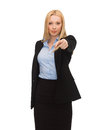 Businesswoman pointing her finger picture of attractive at you Stock Photography