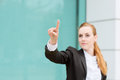 Businesswoman pointing at something young blurred with finger Royalty Free Stock Photo