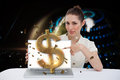 Businesswoman pointing to her laptop showing dollar sign digital composite of Royalty Free Stock Photo