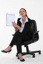 Businesswoman pointing to a list Stock Photography