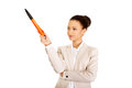 Businesswoman pointing up with big pen african Royalty Free Stock Images