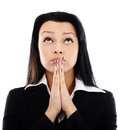 Businesswoman praying closeup portrait of looking up isolated on white background Royalty Free Stock Photography