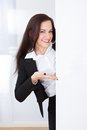 Businesswoman presenting blank billboard portrait of happy young in office Stock Photos