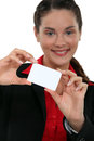 Businesswoman presenting her card Stock Images