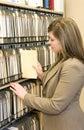Businesswoman Pulling File Folder Royalty Free Stock Photo