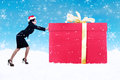 Businesswoman push christmas gift in snow Stock Image