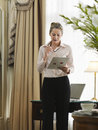 Businesswoman reading document in home office middle aged Royalty Free Stock Images